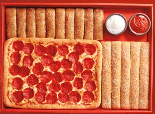 Domino's Pizza announces a pizza makeover for it's 50th anniversary - a new pizza recipe with seasoned crust, a bold new sauce & shredded cheese.